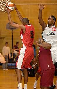 Top scorer with 29 points, Cardinals' Searle (#5) grabs a rebound from Craig Pringle (#15).