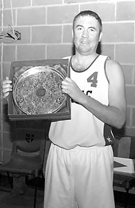 Coach McCusker with the Ernie Oliver Memorial Trophy. (Converted to B&W due to colour issues.)
